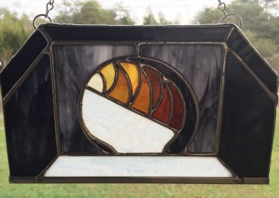 stained glass hanging - the tunnel entrance lit from within