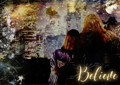 Catherine and Vincent on her balcony, gazing out on the city, his arm around her waist. In the sky, Santa and his sleigh fly by. Text reads: Believe
