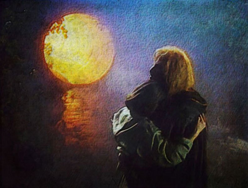 Vincent and Catherine in a reunited embrace, standing in the light of the park tunnel entrance