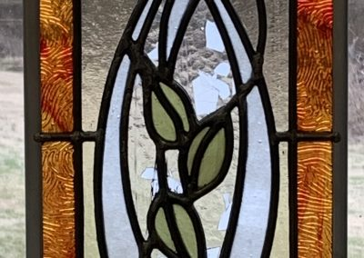 A stained glass panel, a BatB-inspired rose in the MacIntosh rose style.