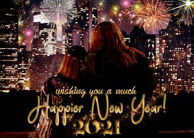 C and V on her balcony, watching fireworks over the NYC skyline. Text reads: wishing you a much Happier New Year! 2021